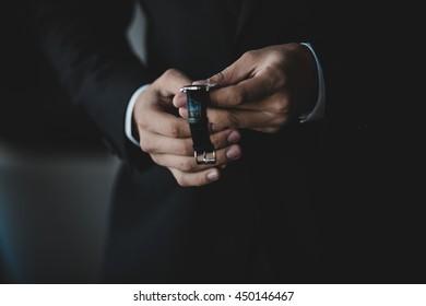 A closeup of man's hands holding a watch