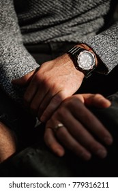 close-up of a man's watch on his hand