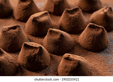 A close-up of the many chocolate truffles covered in cocoa powder