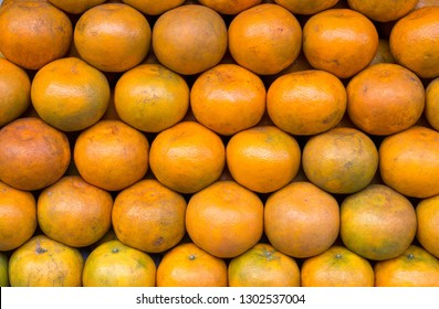 Closeup of many oranges on a fruit shop in market.