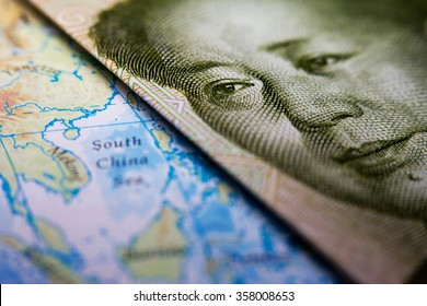 Close-up of Mao Zedong on a 1 yuan Chinese banknote on top of a map showing the South China Sea