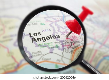 Closeup of a map of Los Angeles, California with red pin and magnifying glass