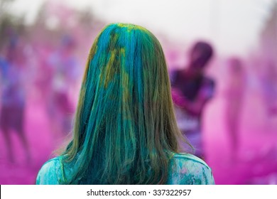 Close-up of marathon, people covered with colored powder in color run event