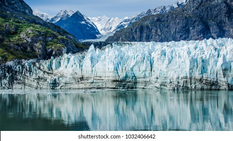 Close-up of Margerie Glacier in Glacier Bay National Park and Preserve in Southeast Alaska which is twenty-one miles long and one mile wide with layers of rock debris mixed with ice.