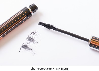 Closeup Mascara Bottle and Brush. Black Mascara wand and Tube Isolated on White. Mascara on Light Background, New Form Brush. Mascara  New Formula on white  Background with Brush Isolated on white