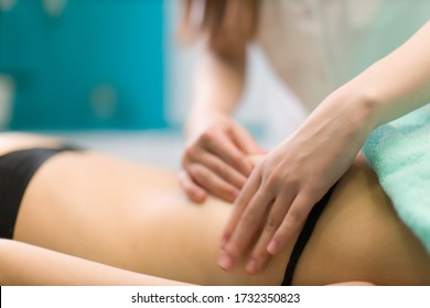 Close-up massage of a white womans  spine