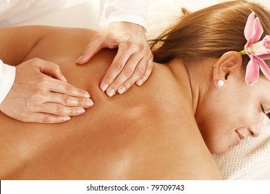 Closeup of masseur's hands doing back massage.?