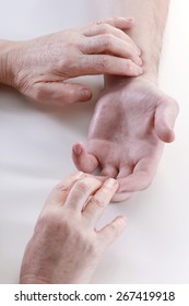 close-up masseur's hands during operation on a white background studio