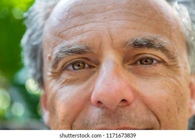 closeup of mature man with green eyes and grey hair