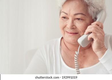 Close-up of mature woman calling