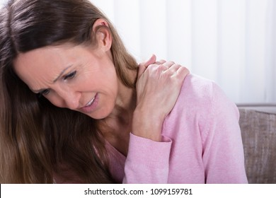 Close-up Of Mature Woman Suffering From Backache