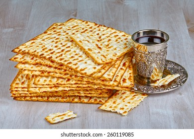 Closeup of Matzah with  cup of wine on wooden table