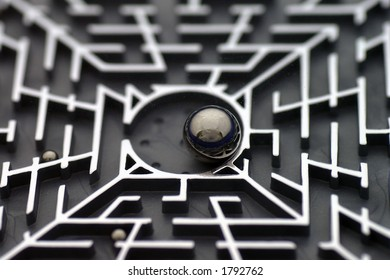 Closeup of a maze puzzle with ball bearings