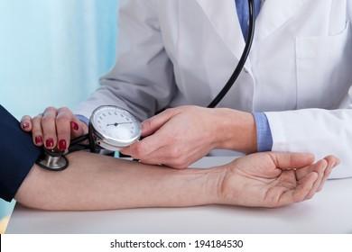 Close-up of measuring blood pressure, horizontal view