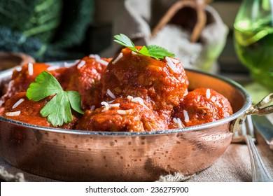 Closeup of meatballs in tomato sauce
