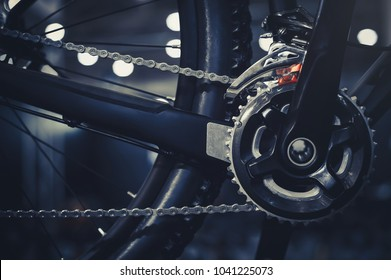 Closeup of a mechanism of bicycle mechanisms and chain on a mountain bike. Pedals from a mountain bike. Close the detailed view.