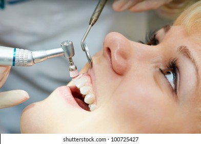 close-up medical dentist procedure of teeth polishing with cleaning from dental deposit and odontolith