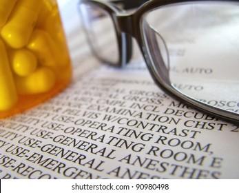 Closeup Of A Medical Hospital Bill, Prescription Medicine And Glasses