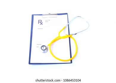 Closeup of medical stethoscope on a rx prescription, isolated on white background