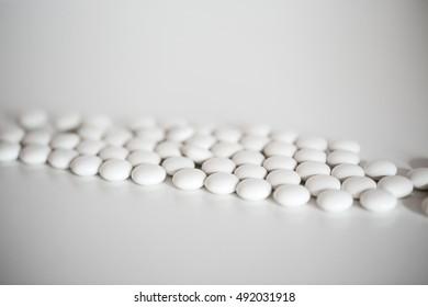 Closeup of medical white pills.