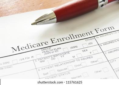 Closeup of Medicare enrollment form and pen