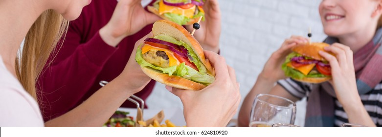 Close-up of meeting with friends in the burger restaurant