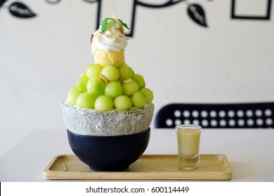 Closeup Melon Bingsu on tray, Bingsu or Bingsoo is a Korean shaved ice dessert with sweet toppings such as ice cream vanilla, whipped cream and sweetened condensed milk. It's very popular dessert.