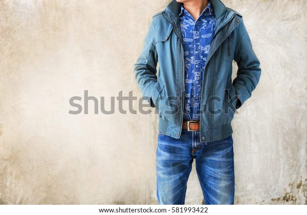 Closeup Men casual outfits denims standing. Concrete background with space for texture. men beauty and fashion concept, Jeans concept