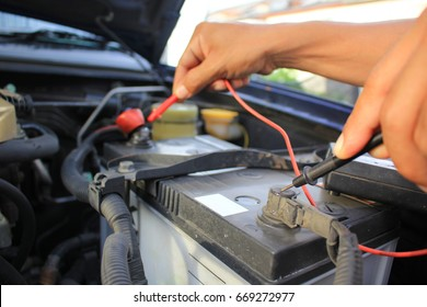 Closeup of Men checking the circuit of the car, Auto mechanic repairing car