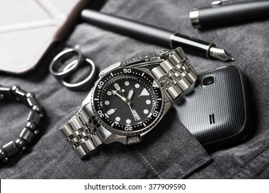 closeup men dive watch with stainless steel bracelet