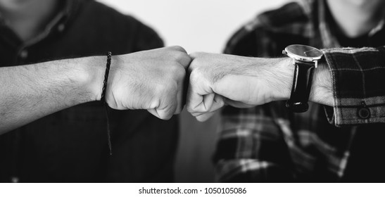 Closeup of men fist bumping