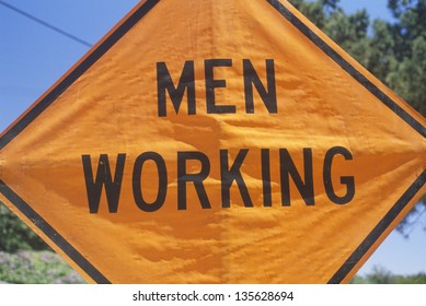 Close-up of Men Working sign