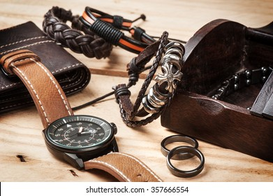 closeup men's accessories on wooden desk
