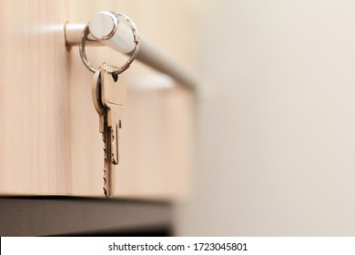 Close-up of metal keys and keychain at home and in the office. Security concept against hacking of apartments, apartments and offices