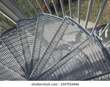 closeup of a metal mesh outdoor staircase