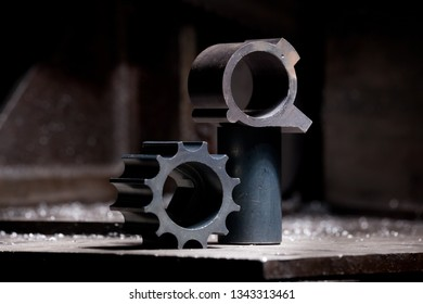 closeup of metallic cogwheels - mechanic steel details on industrial background