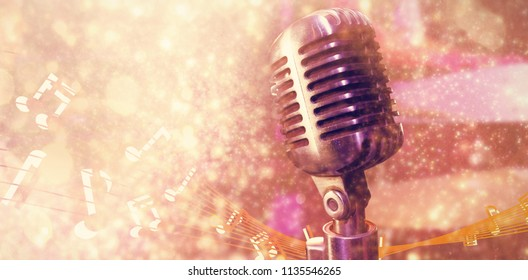 Close-up of microphone  against white snow and stars on black