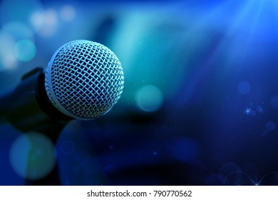 Close-up of microphone in concert hall or conference room,graphic design background.Mixed media
