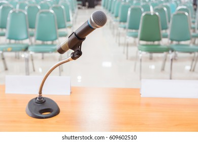 Close-up of Microphone in Empty Meeting Announcement Room or Conference Hall as Organization Communication or Public Relation Concept.