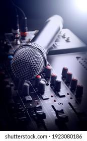 Closeup microphone over the audio mixer
