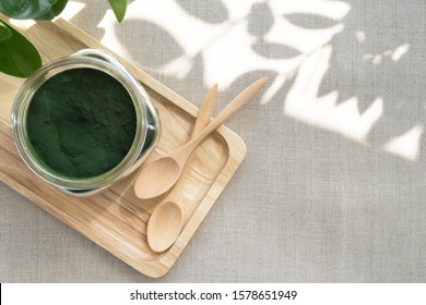 Closeup of microscopic blue-green algae - spirulina powder in a glass jar, it is excellent dietary supplement for Vegan, Vegetarian or Plant based diet because it containing multivitamins include B12.