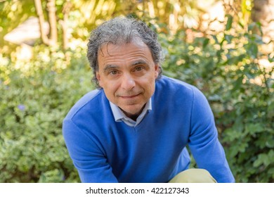 close-up of middle-aged man in a garden