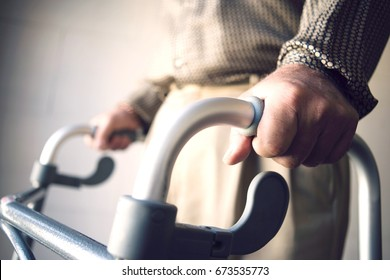 Closeup midsection of a man using walking frame