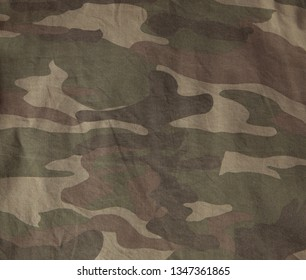 Closeup of military uniform surface. Texture of fabric, close-up, military coloring.
