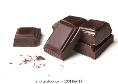 closeup of milk chocolate blocks on white background