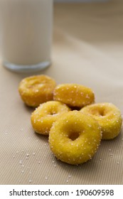 closeup mini sugar coated doughnuts of a pile and milk