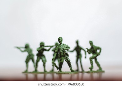 Close-up of miniature plastic toy soldiers at war. Concept of courage, fighting and patriotic spirit. Selective focus