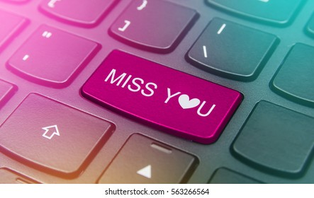 Close-up the Miss you button on the keyboard and have pink color button