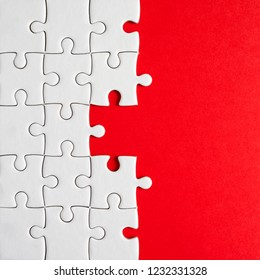 Closeup missing jigsaw group on red background (Business Concept)