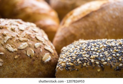 Close-up of Mixed baked Bread and Bread rolls usable as decorative Background.